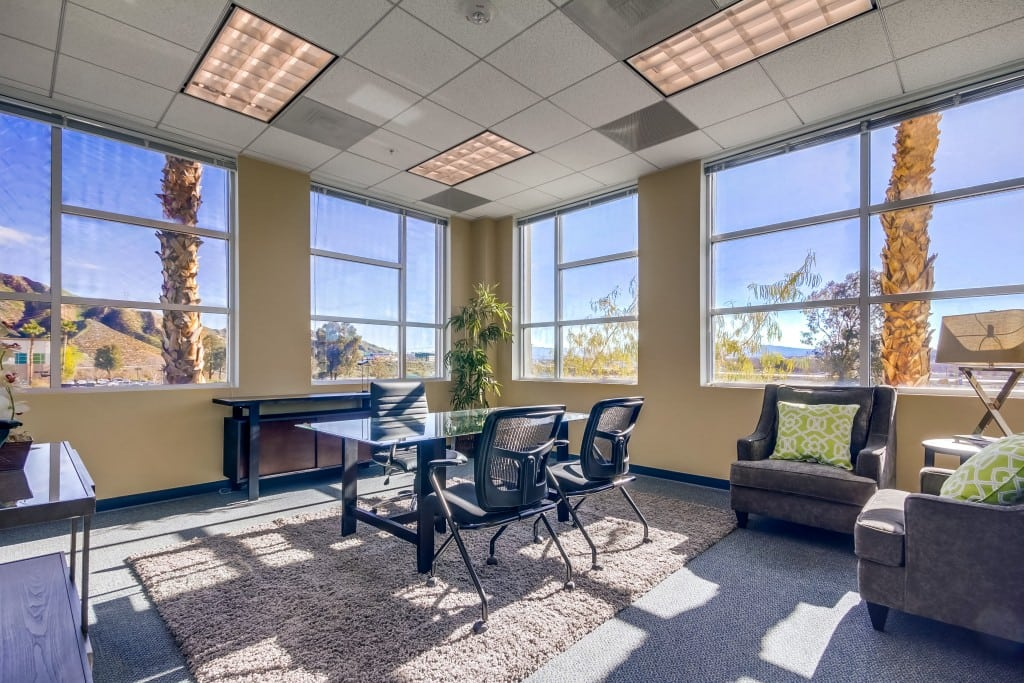 sought after office location in valencia- office interior with wide window views of california landscape