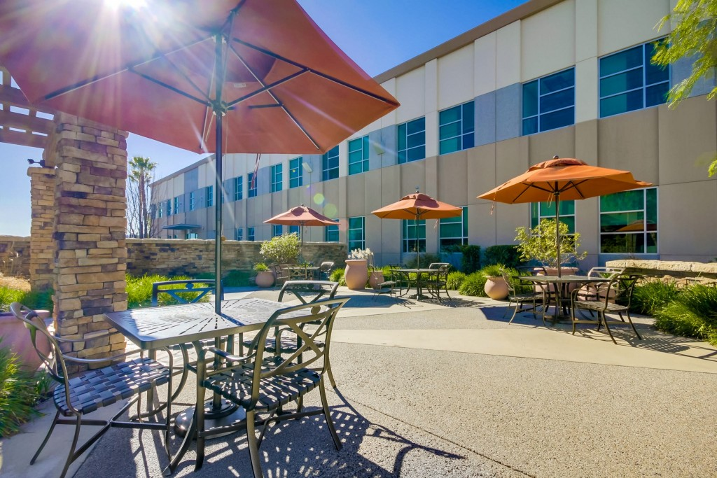 outside VIRTUAL OFFICES IN CALIFORNIA's valencia location chairs with orange umbrellas
