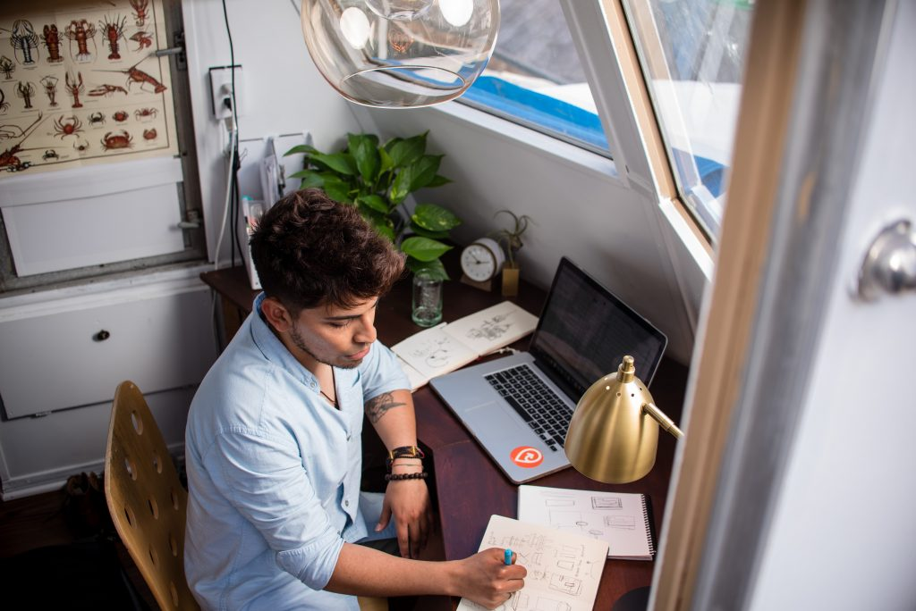 man sitting at desk and working remotely